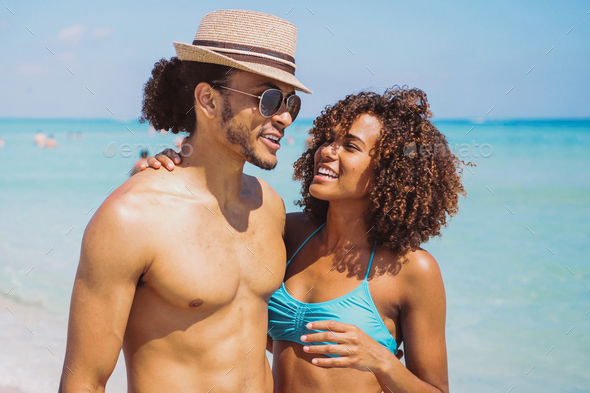Couple standing and embracing at oceanside - Stock Photo - Images