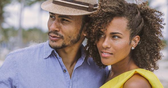Ethnic couple looking away - Stock Photo - Images