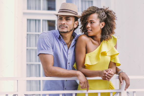 Couple standing on terrace - Stock Photo - Images