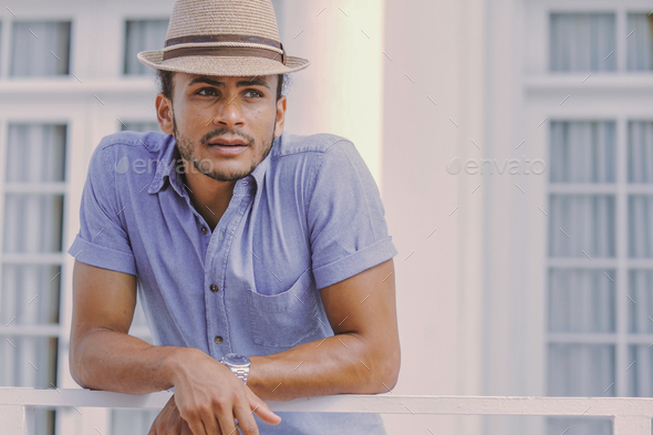 Handsome man at handrail - Stock Photo - Images