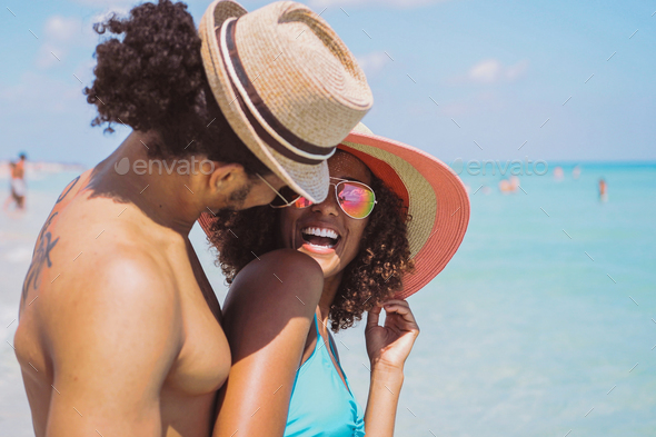 Happy laughing romantic couple at seaside - Stock Photo - Images