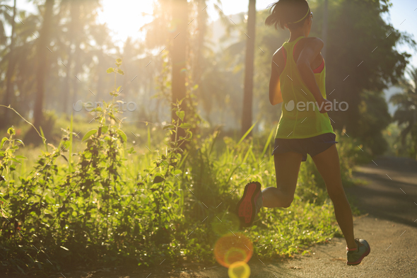Running in sunrise forest - Stock Photo - Images