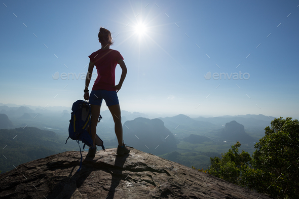 Successful hiker in the sunrise mountain top - Stock Photo - Images