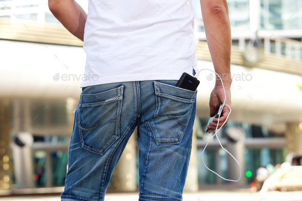 Mobile phone with battery pack in back pocket - Stock Photo - Images