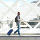 Man walking with suitcase and cellphone - PhotoDune Item for Sale