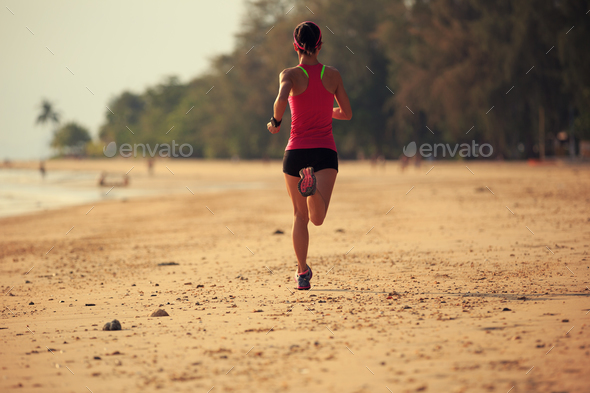 Running on beach - Stock Photo - Images
