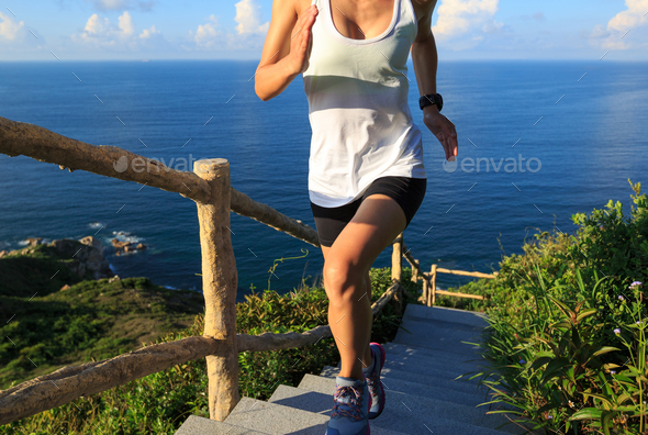 Running upstairs on seaside in the morning - Stock Photo - Images