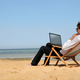 laptop on the beach - PhotoDune Item for Sale