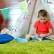 Little Boy Is Reading Book in His Self Made Wigwam in Playroom - VideoHive Item for Sale