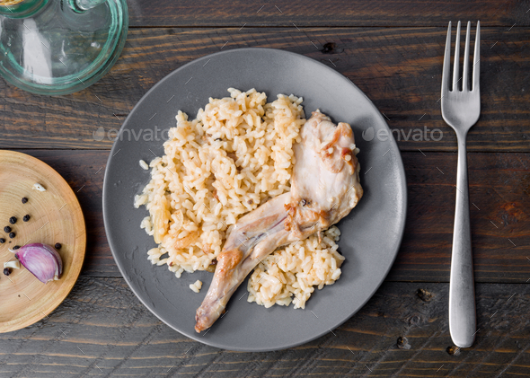 overhead shot Rabbit dish stewed with rice on wood - Stock Photo - Images