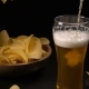 Potato Chips Are Poured Into a Wooden Bowl and Beer Is Poured Into a Glass - VideoHive Item for Sale