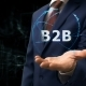 Businessman Shows Concept Hologram B2B on His Hand - VideoHive Item for Sale