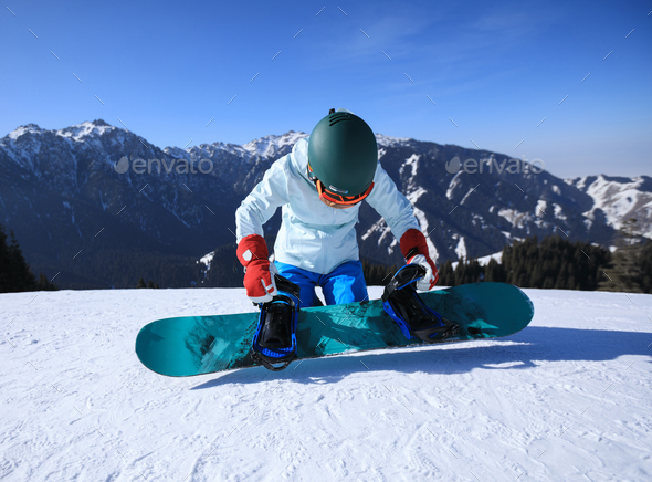 Snowboarding on alpine mountains - Stock Photo - Images