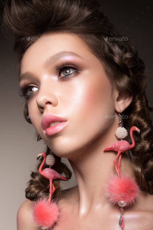 Glamour portrait of beautiful girl model with makeup and romantic hairstyle. - Stock Photo - Images