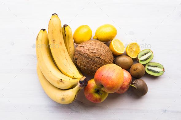 Fruit banana coconut lemon apple kiwi - Stock Photo - Images