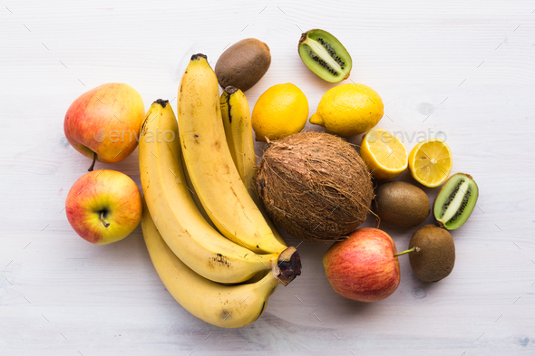 Fruit banana coconut lemon apple kiwi - Stock Photo - Images