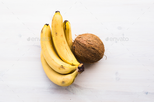 coconut and bananas on the wood background - Stock Photo - Images