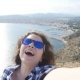 Happy Woman Traveler in Sunglasses Makes Selfie with Sea and Mountain View - VideoHive Item for Sale
