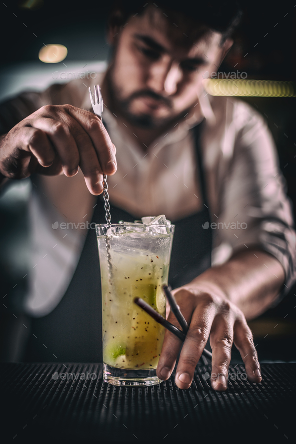 Bartender is stirring cocktail - Stock Photo - Images