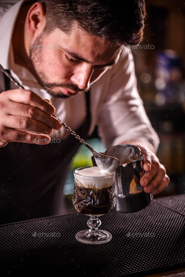 Bartender decorated alcoholic coffee - Stock Photo - Images