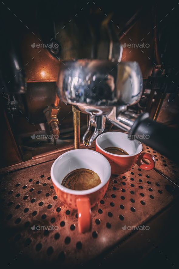 Brewing two espresso's - Stock Photo - Images