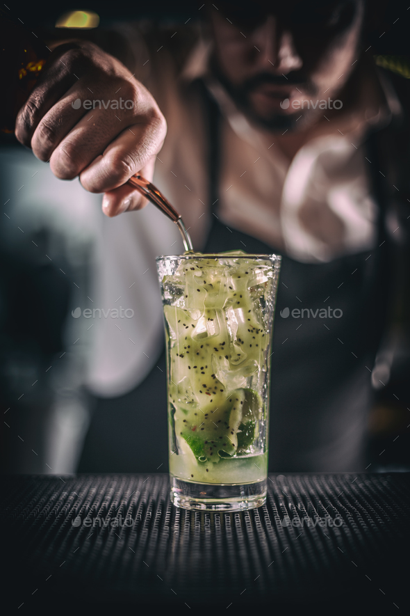 Man hands pouring alcoholic drink - Stock Photo - Images