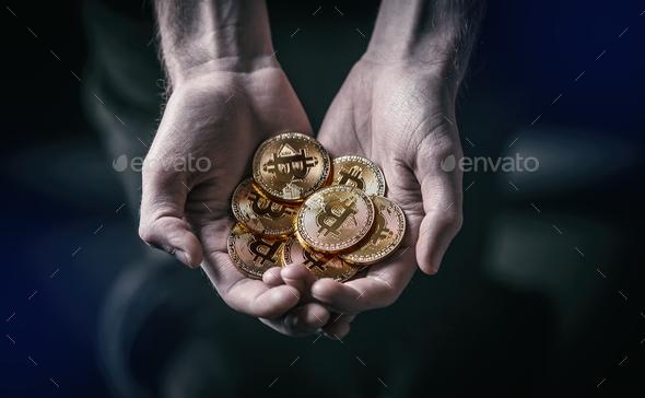 Man holding Bitcoin - Stock Photo - Images