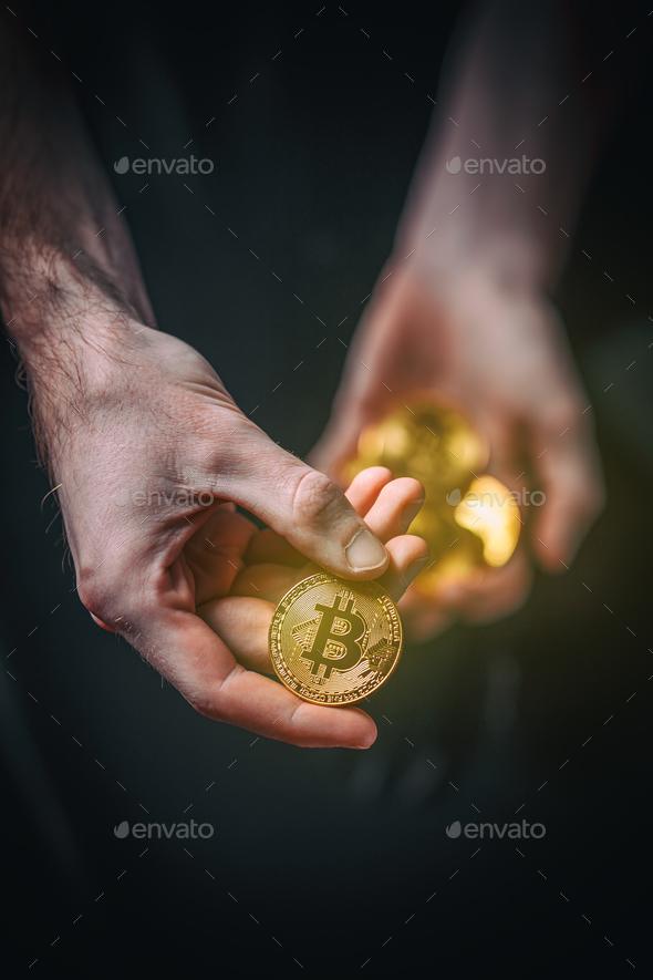 Man holding Bitcoin. - Stock Photo - Images