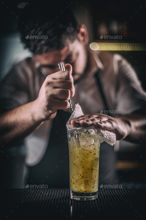 Barman mixing a cocktail - Stock Photo - Images