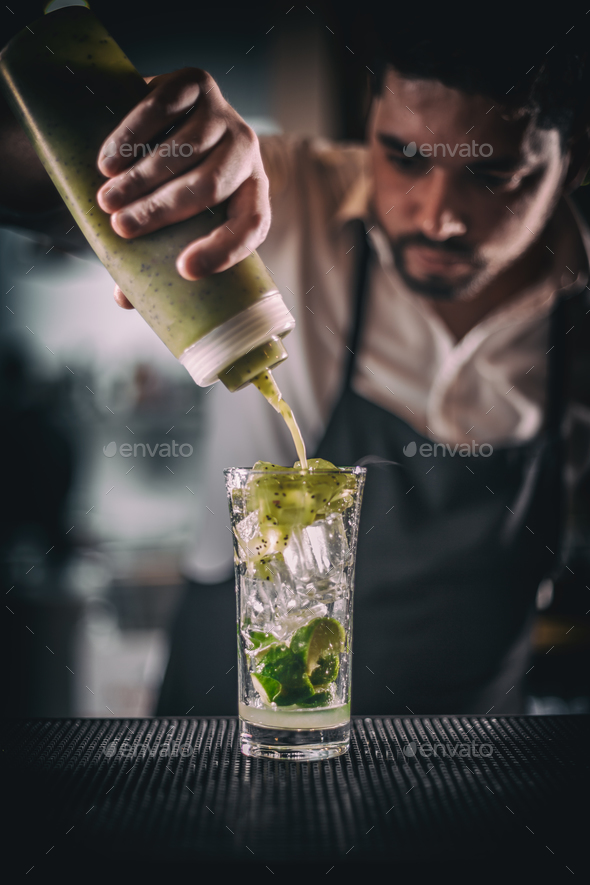 Barman pouring sweet syrup - Stock Photo - Images