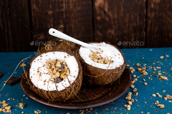 Healthy breakfast in coconut bowl. - Stock Photo - Images