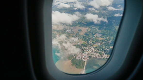 View Through An Airplane Window On The Tropical Island Ocean Sea