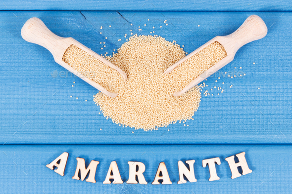 Heap of amaranth with wooden scoop as source vitamins, minerals and dietary fiber - Stock Photo - Images