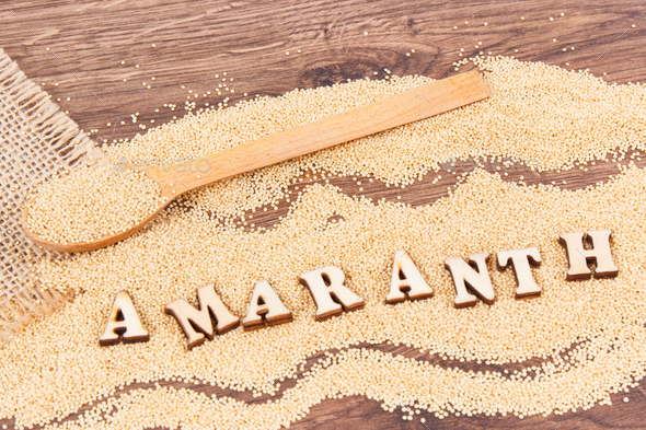 Inscription amaranth and seeds containing vitamins, minerals and fiber, healthy and gluten free food - Stock Photo - Images