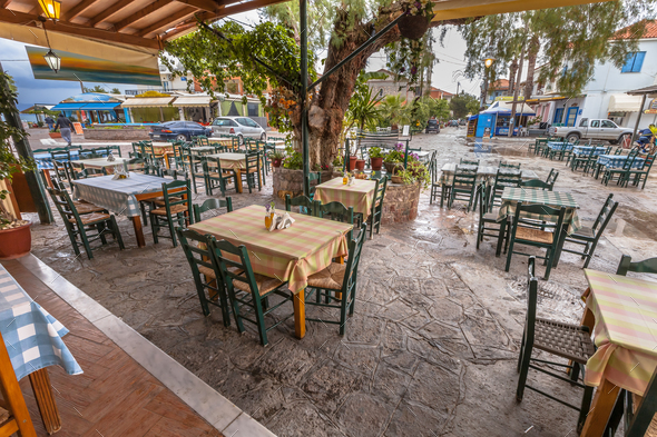 Traditional Village Restaurant terrace around big tree - Stock Photo - Images