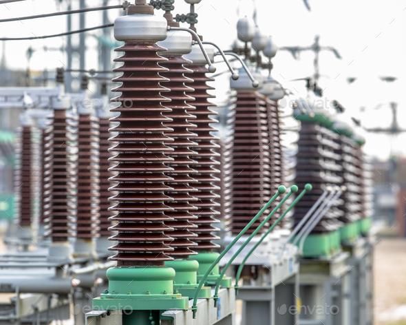 Vintage ceramic isolators on power substation - Stock Photo - Images