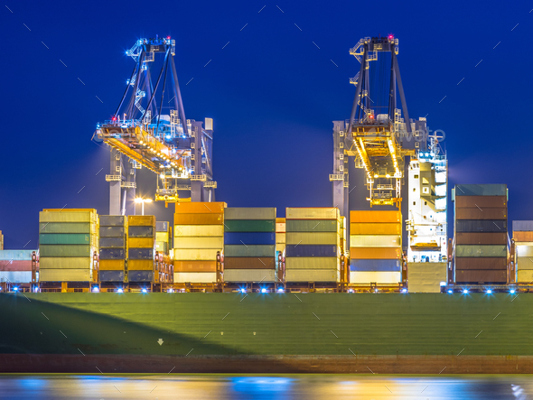 Container ship unloading in automated harbor - Stock Photo - Images