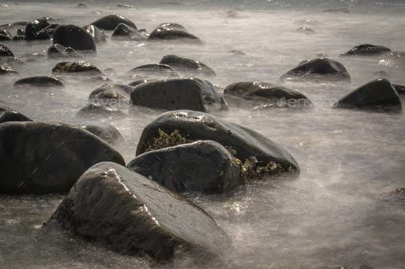 Rocky Stones in Blurred Water by Long Exposure - Stock Photo - Images