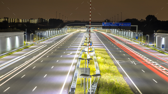 Motorway with tunnel at night - Stock Photo - Images