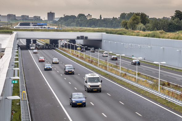 Afternoon traffic on motorway in Randstad - Stock Photo - Images