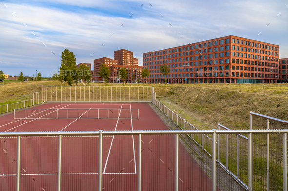 Tennis field near offices - Stock Photo - Images