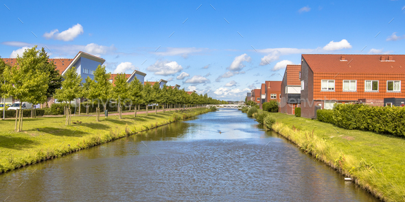 River in modern suburb neigborhood - Stock Photo - Images