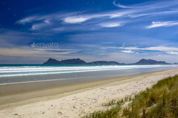 White Sand Beach With Blue Sky at Waipu in New Zealand - Stock Photo - Images