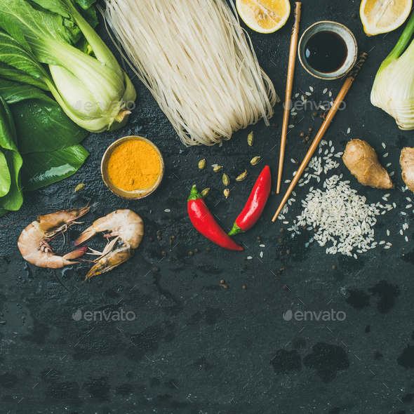 Asian cuisine ingredients over dark slate stone background, square crop - Stock Photo - Images