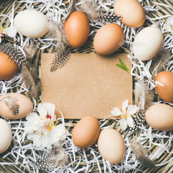 Natural colored eggs for Easter in basket, square crop - Stock Photo - Images