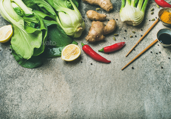 Flat-lay of Asian cuisine ingredients over concrete background, copy space - Stock Photo - Images