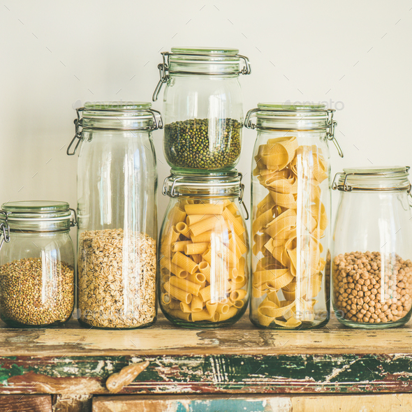 Uncooked cereals, grains, beans and pasta on table, square crop - Stock Photo - Images