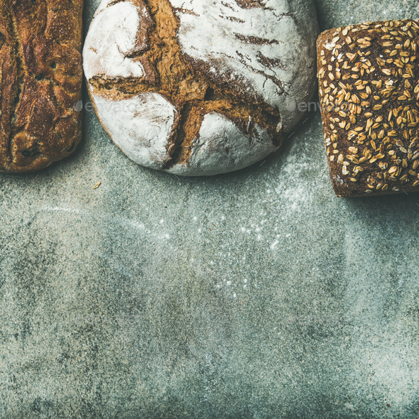Top view of bread loaves over grey background, square crop - Stock Photo - Images