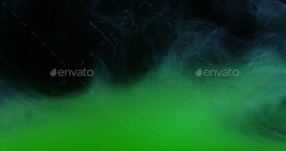 Green Ink Colors in Water Creating Liquid Art Shapes - Stock Photo - Images