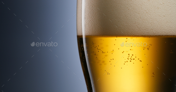 Alcoholism And Addiction Issues Lager Beer Pouring Into Glass - Stock Photo - Images